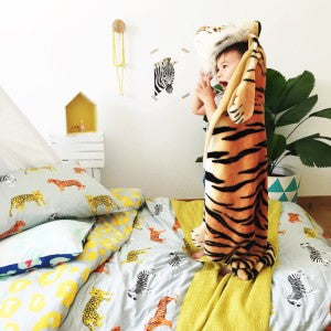 Roar featuring a real live tiger. Styled by Affordable Style Files