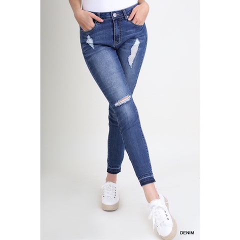 Distressed Skinny Jeans with Raw Hem Detail