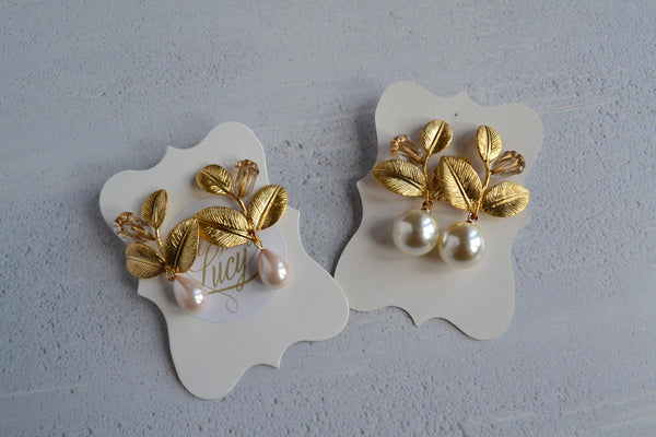 Statement  golden leafed pearl earrings