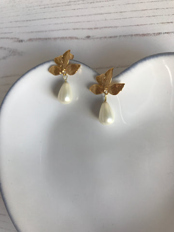 Golden leaf and pearl drop earrings