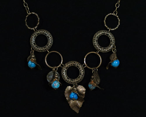"""Antique Brass and Blue Agate"" Madonna Reisz Bush, jewelry designer"