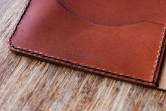 hand and hide leather tablet case detail shot hand stitching