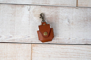 Hand and Hide leather airpod case in honey brown, front of case