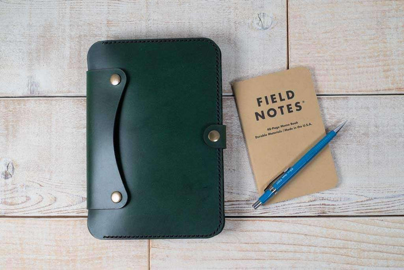hand-stitched tablet case in green leather