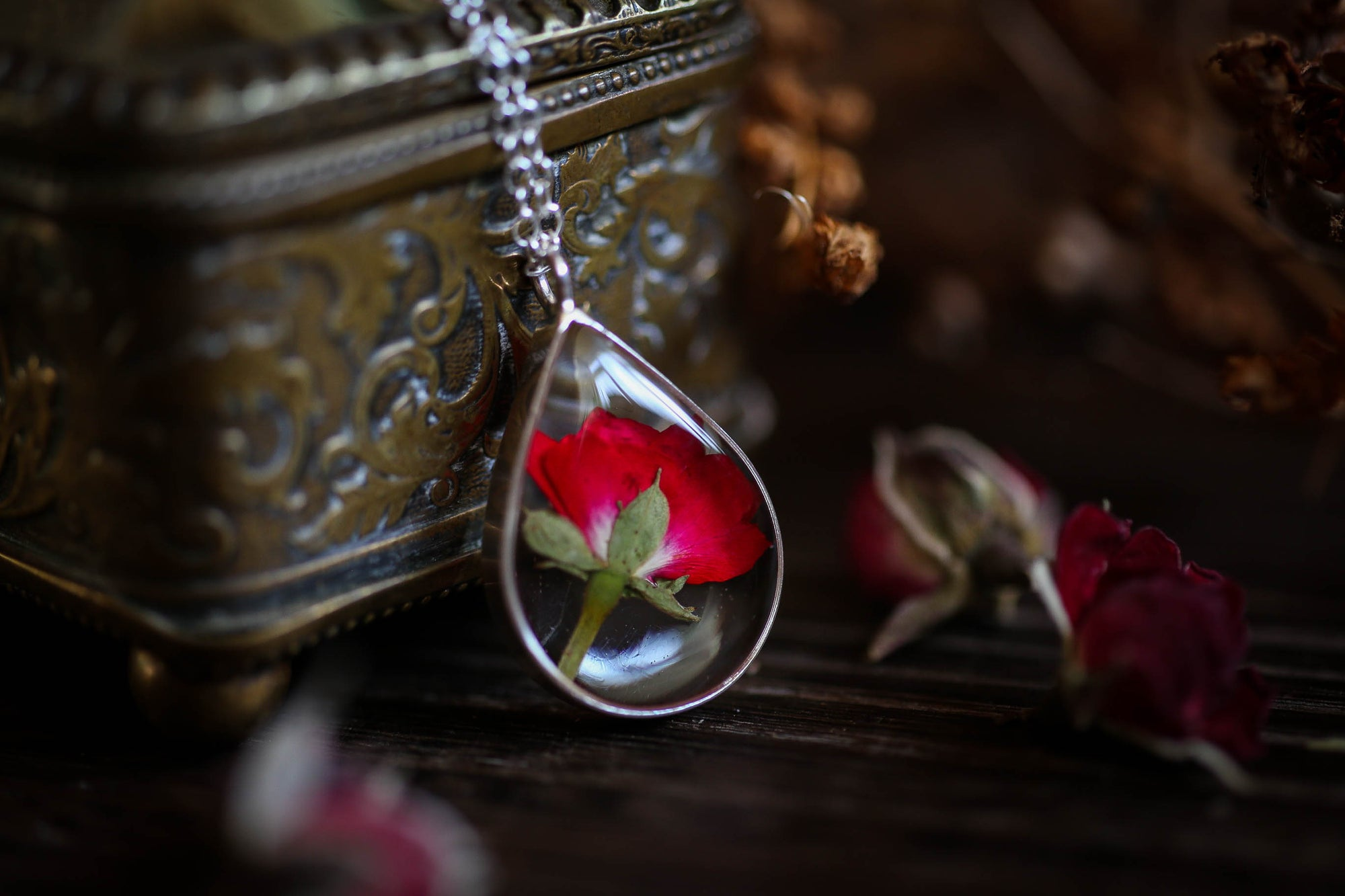 Sterling silver rosebud locket necklace
