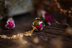 Rose, moss and gold leaf pendant