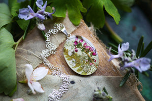 Silver locket necklace with flowers