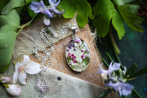 pink and green flower necklace on silver chain