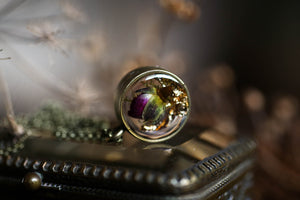 Rose bud and gold leaf locket
