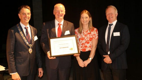 Pharmaceutical Society of New Zealand National President Dale Griffiths, southland pharmacist Bernie Mckone and his daughter Sarah, and Colin Abercrombie, of MIMS Publishing, at a pharmacy symposium in Auckland in which Mckone was named New Zealand Pharmacist of the Year. NZ Pharmaceutical Society