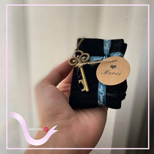 Velvet bag with key medal