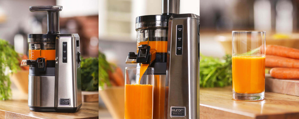 Hurom HZ Slow Juicer making orange juice in kitchen