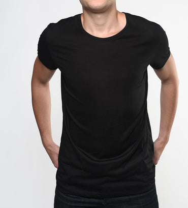 Man in a black supima cotton t shirt from front