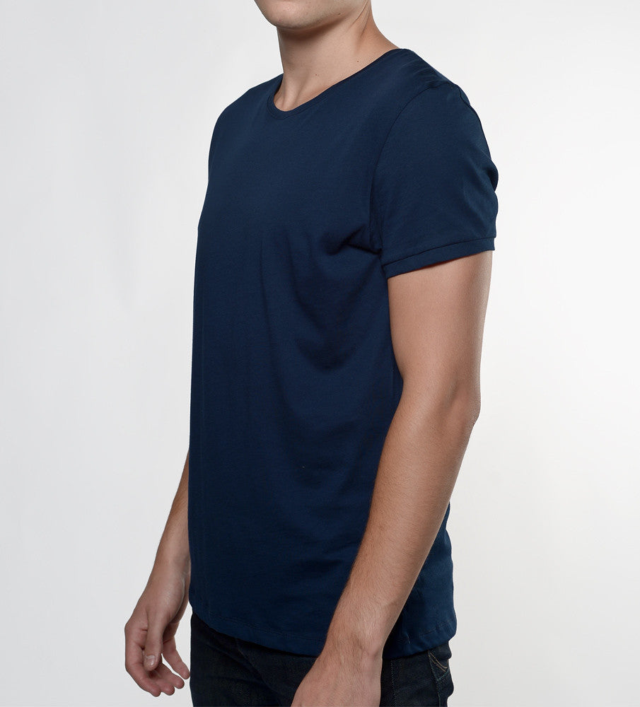 Man in a navy tshirt from side