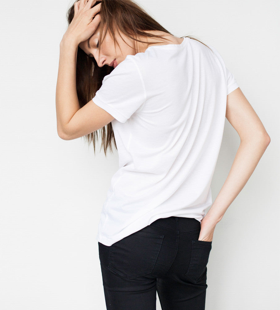 Women from the back in a white T shirt