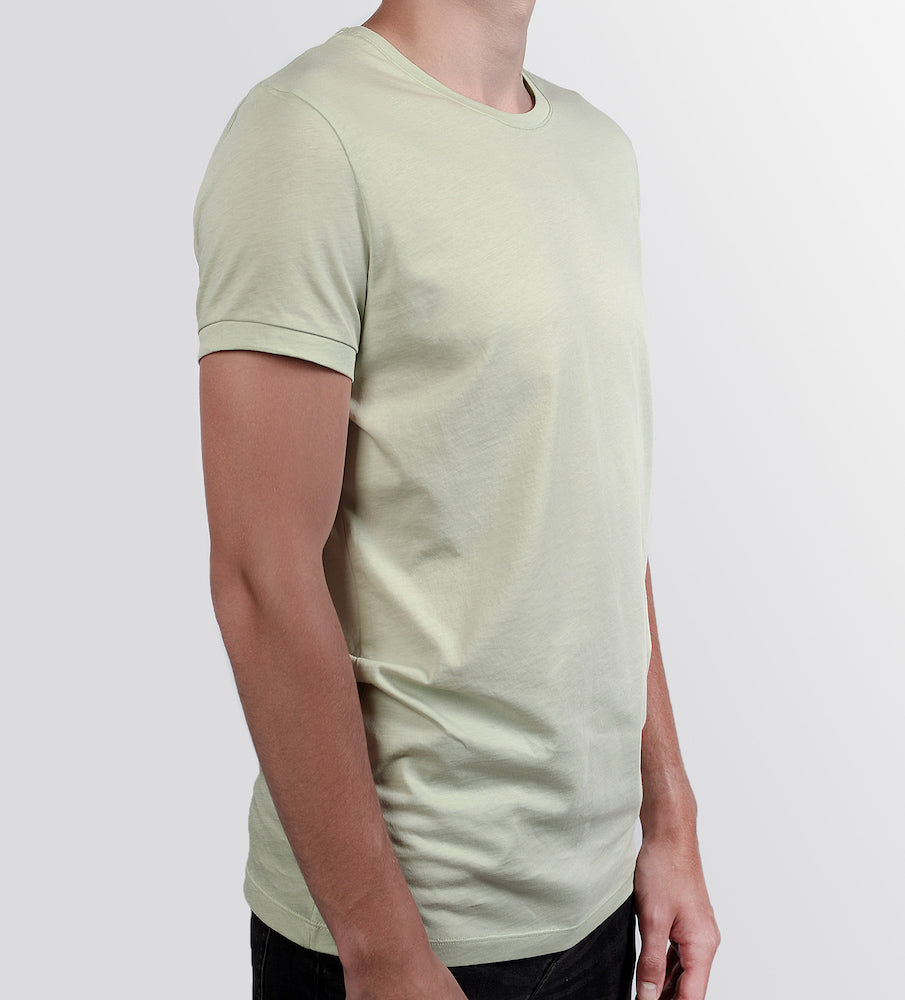 Man in a mint tshirt from side