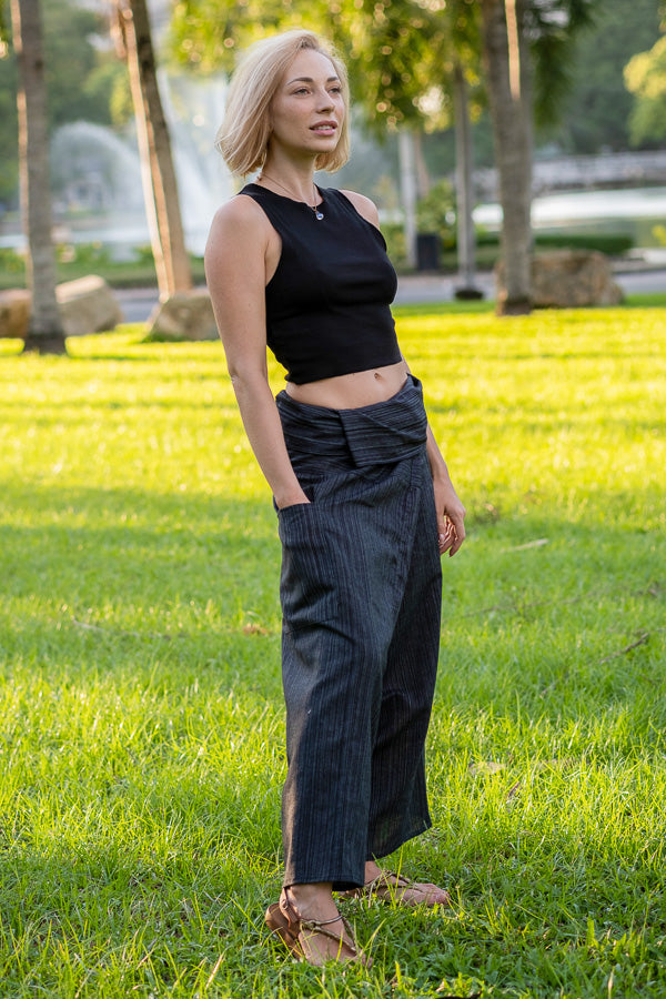 Woman in park wearing gray fisherman pants