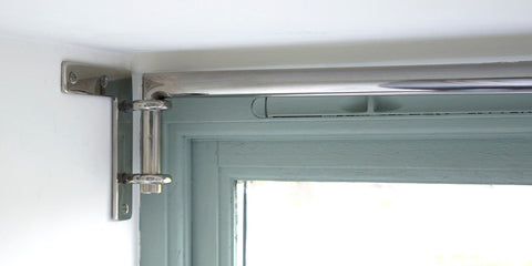 Drapery Arm Fitted Close to the Ceiling in a Dormer Window