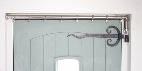 Stainless Steel Drapery Arm fitted in a door recess with L-shaped bracket