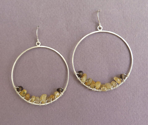 big hoop earrings with gemstones