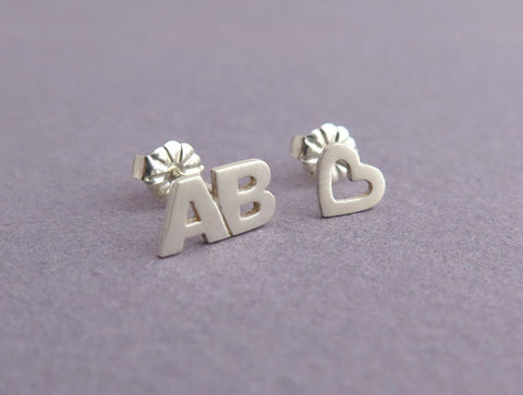 letters and heart earrings