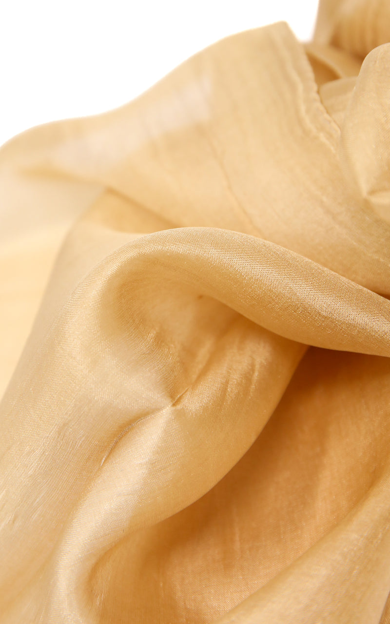close up of Rich gold summer stylish pure silk neutral coloured scarf