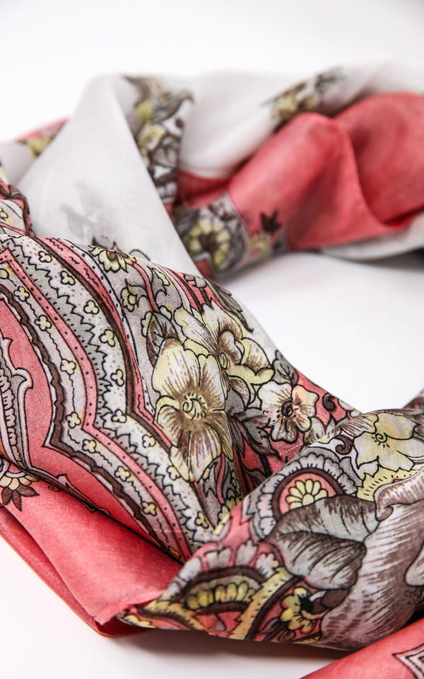 close up of 100% silk scarf coral printed design with pink and white accents