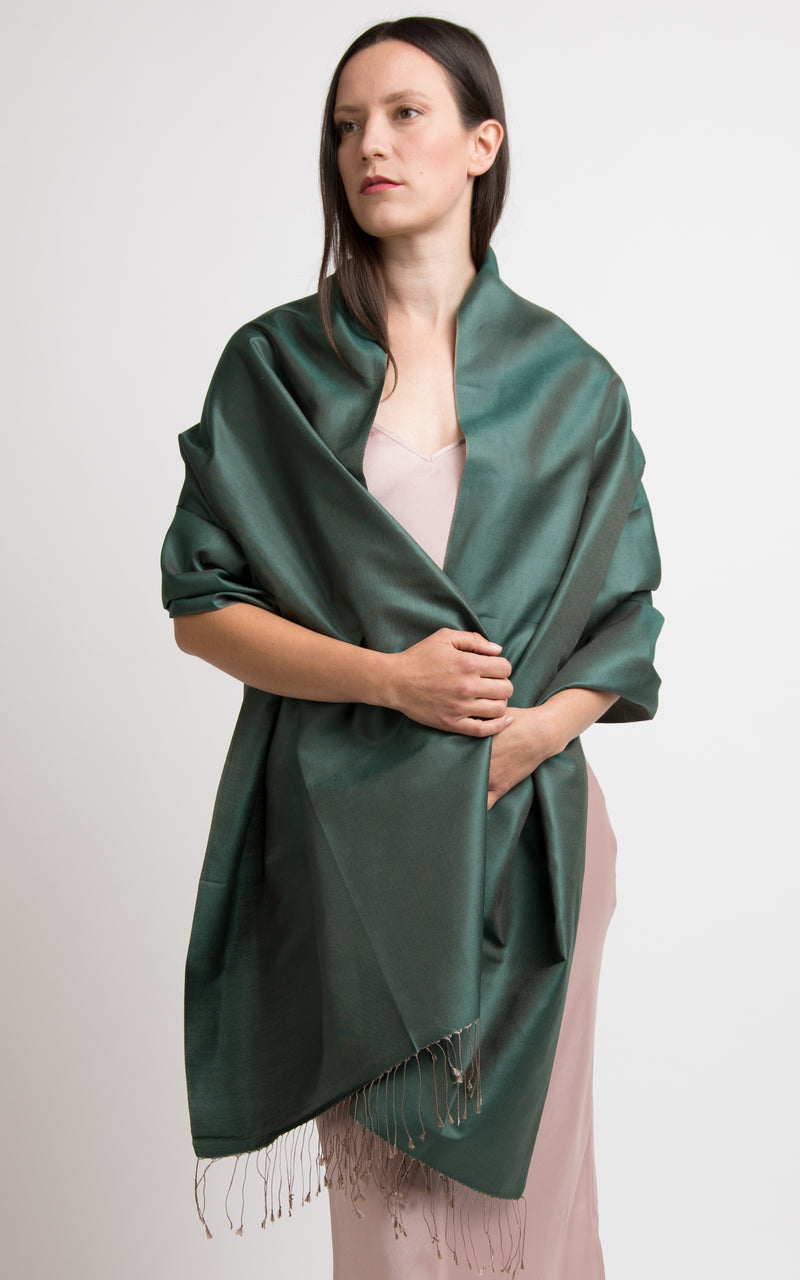 model wearing reversible green silk scarf as a silk wrap pashmina shawl made in tibet The Little Tibet London