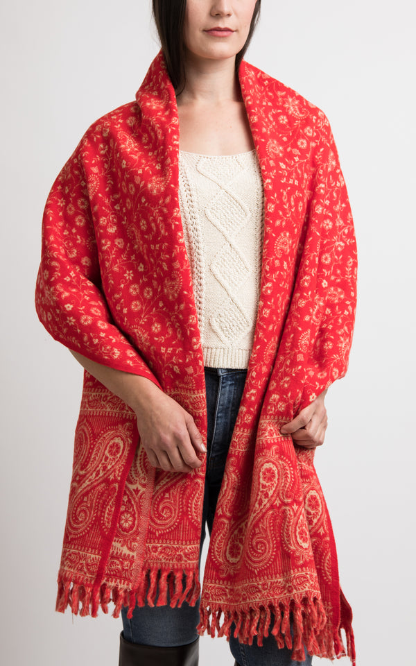 Vibrant red chunky knit scarf styled as a wrap