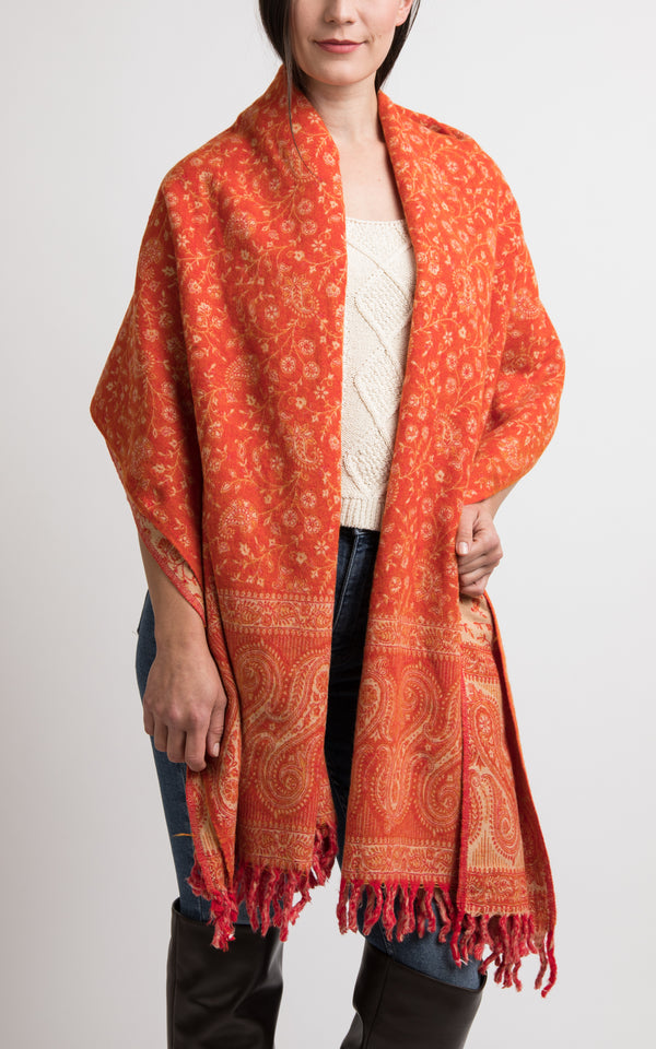 Tangerine orange with bright tassels chunky knit styled as shawl
