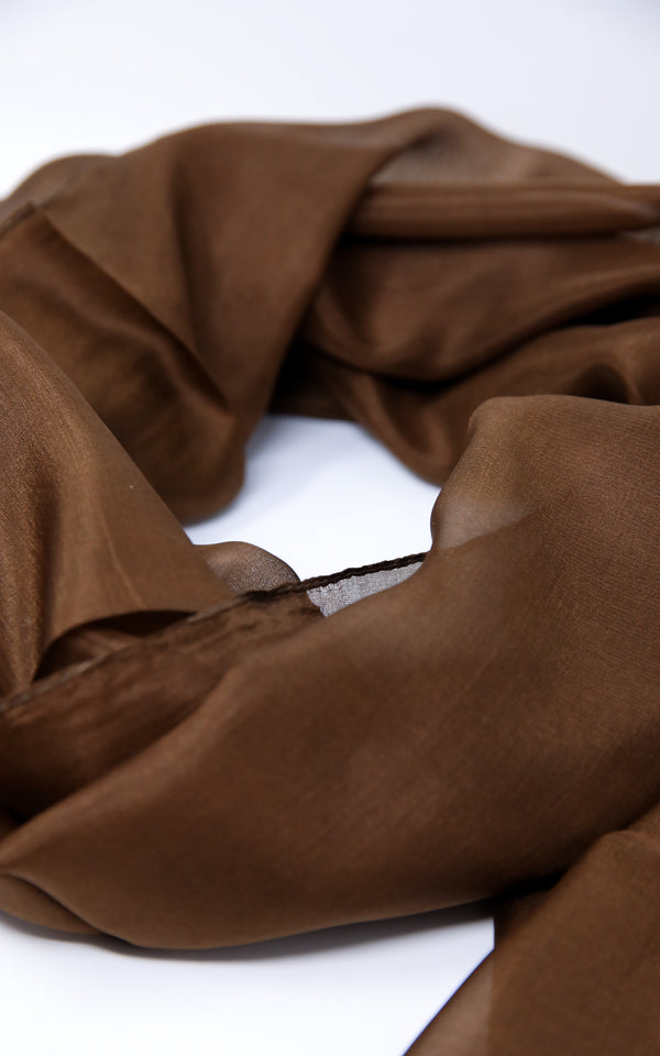 close up of Rich brown lightweight neutral coloured pure silk scarf