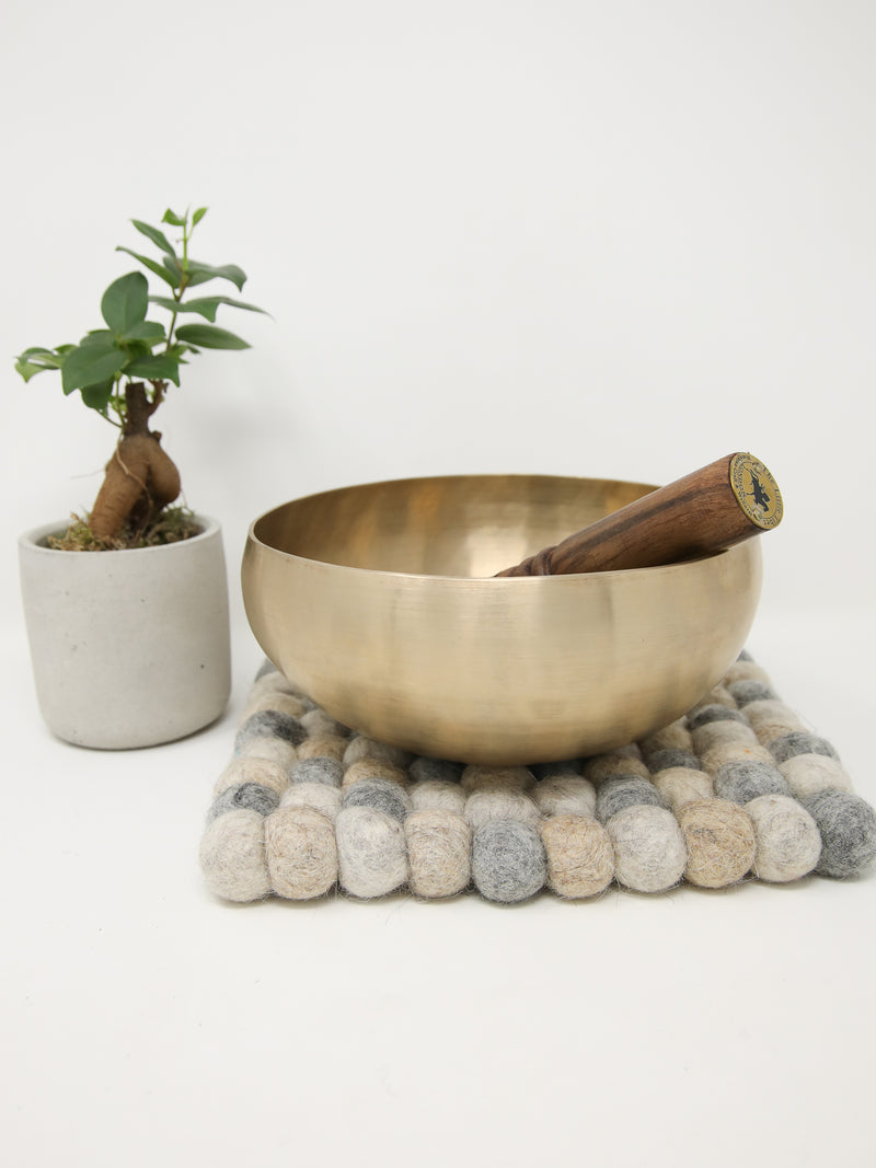 singing bowl on top of felt cushion, made of felt balls, made in Nepal