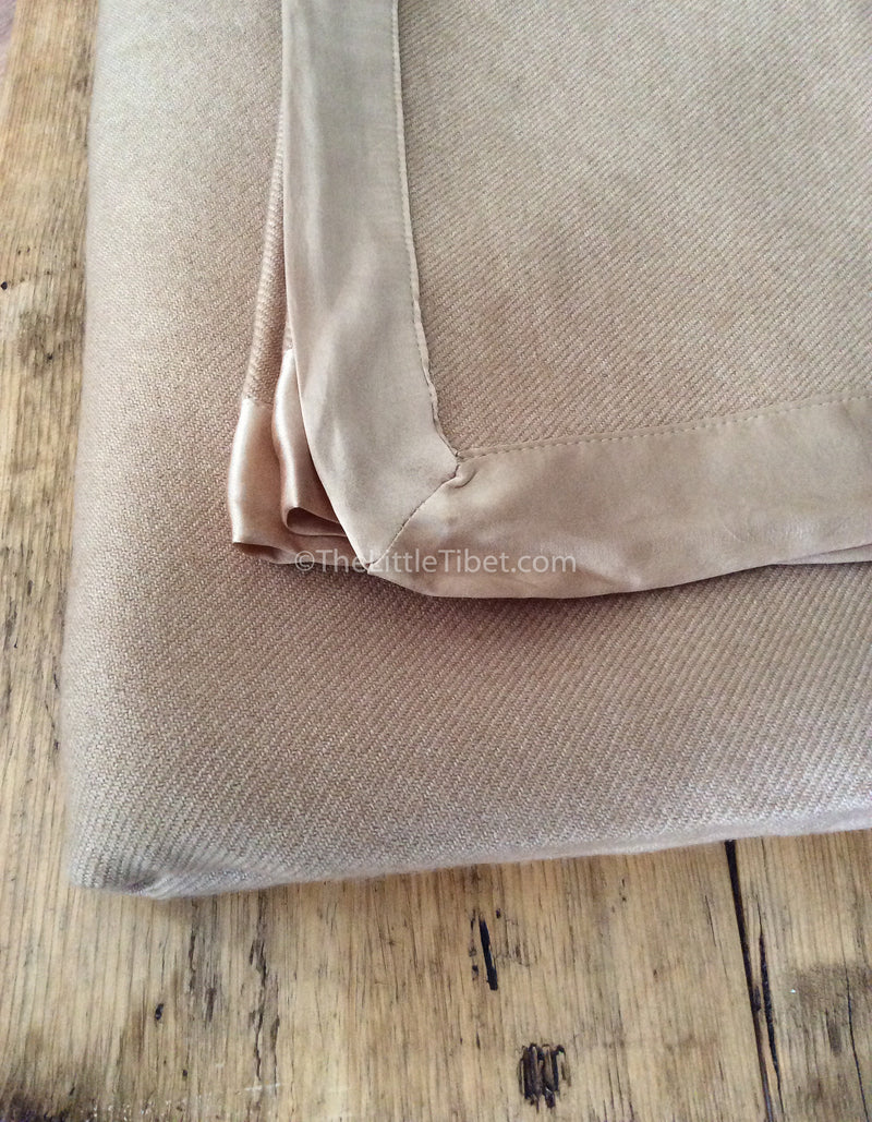 Camel coloured Mongolian cashmere deluxe 100% pure cashmere blanket corner close up
