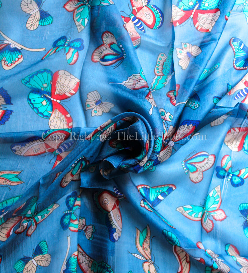 Butterfly patten close up of Bright blue100% silk square shaped scarf