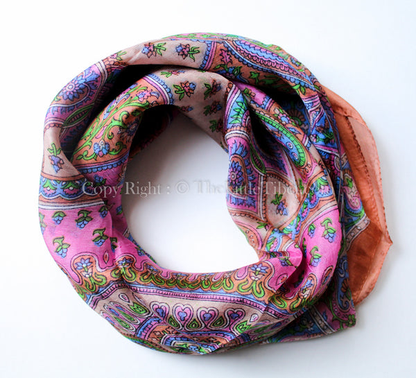 Square shaped 100% silk scarf with paisley detail and candy pink, blue and green detail