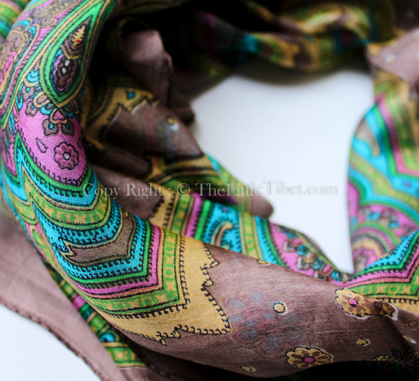 close up 100% silk scarf brown and yellow paisley design with vibrant green accents
