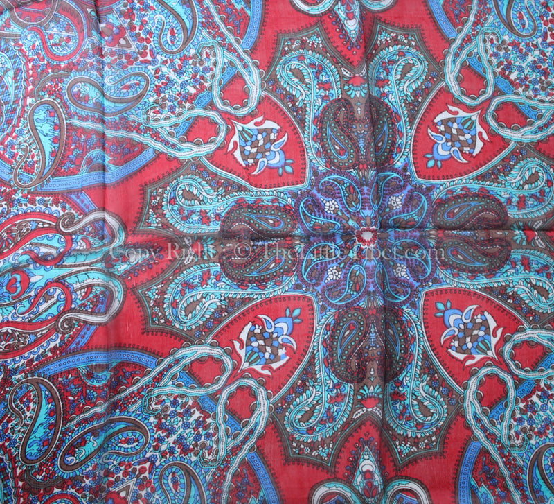 Paisley pattern close up of Crimson red and turquoise square shaped 100% silk scarf