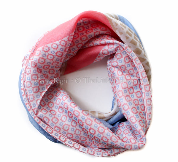 Square shaped 100% silk scarf with baby blue, light coral and brown detail