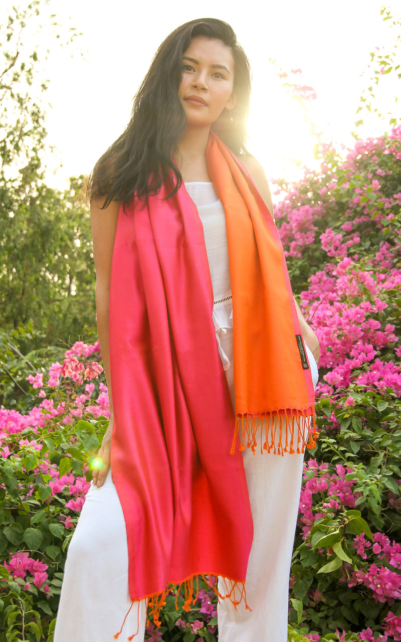 model wearing Luxury 100% pure silk fuschia bright orange  reversible pashmina