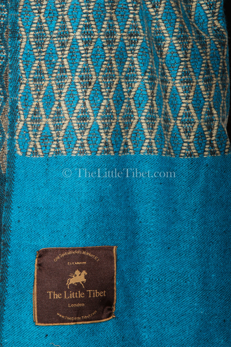 Close up Turquoise blue Diamond patterned  baroque design Himalayan   Tibet shawl
