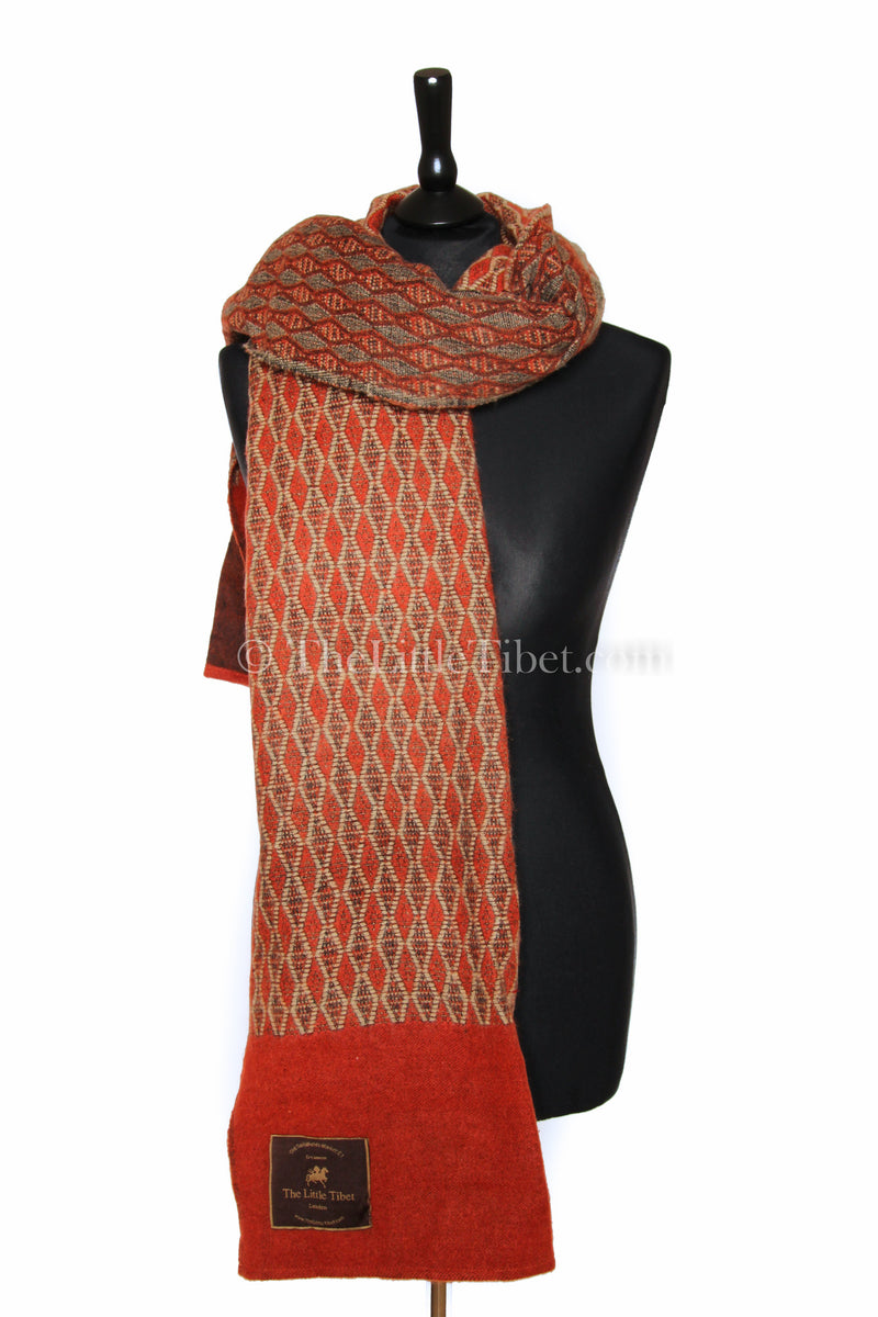 Red orange Diamond patterned   Himalayan   Tibet shawl  draped around shoulders