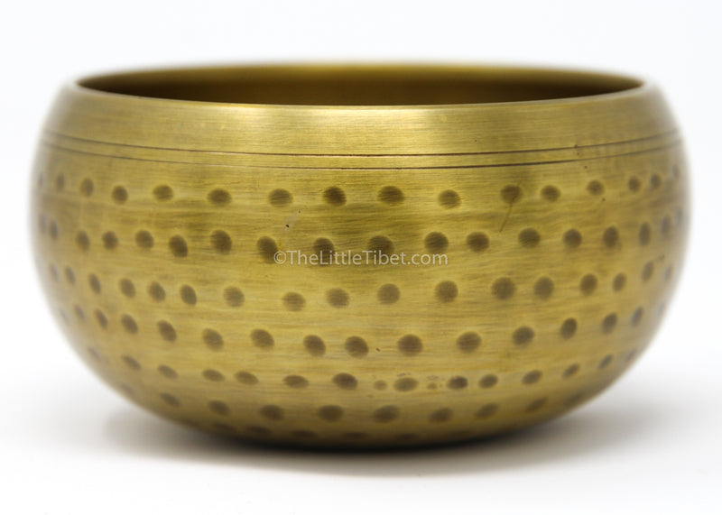 large gold brass singing bowl sound therapy chakra realigning himalayan instrument side close up