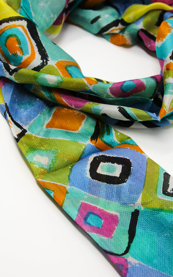 Geometrical designed summer luxury silk scarf with vibrant blue, yellow and green shapes