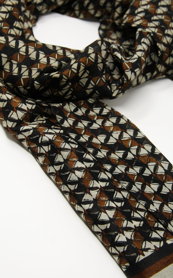 Close up of classic neutral brown, black and beige pure silk scarf with contemporary patterns