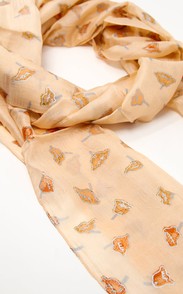 Close up of Light beige soft touch lightweight elegant pure silk summer scarf with small detail