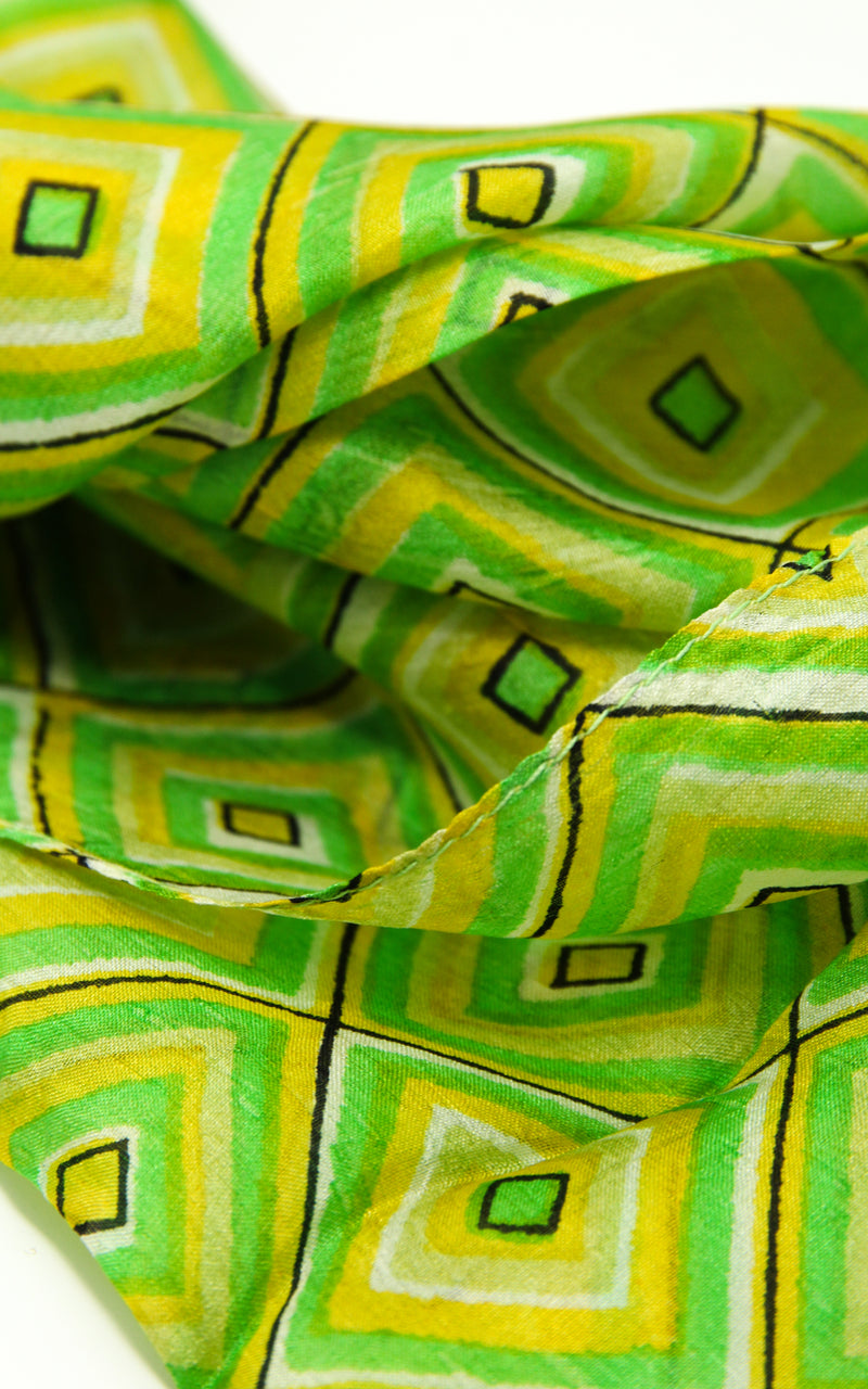 Close up of Vibrant green pure summer silk scarf with geometric shapes