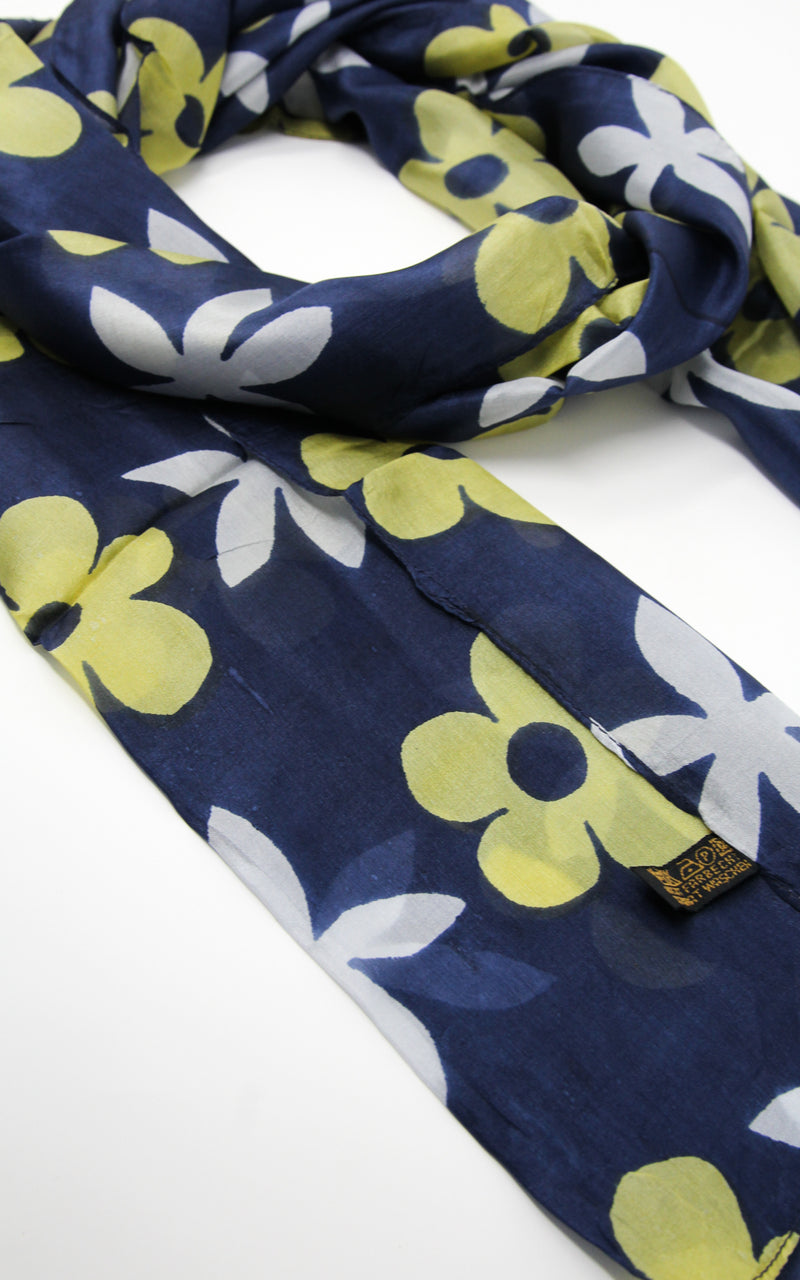 Close up of Dark navy floral summer pure silk scarf with bright yellow and white flower design