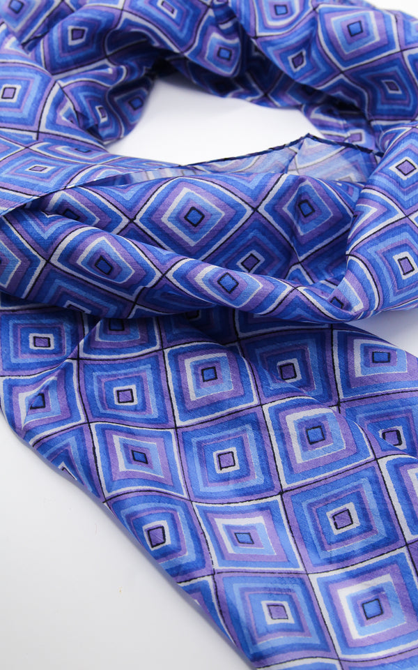 Close up of Purple blue patterned summer elegant 100% silk scarf with shape detail and design