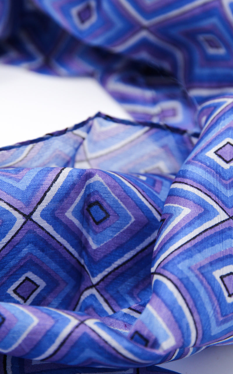Close up of Purple and blue patterned summer elegant 100% silk scarf with shape detail and design
