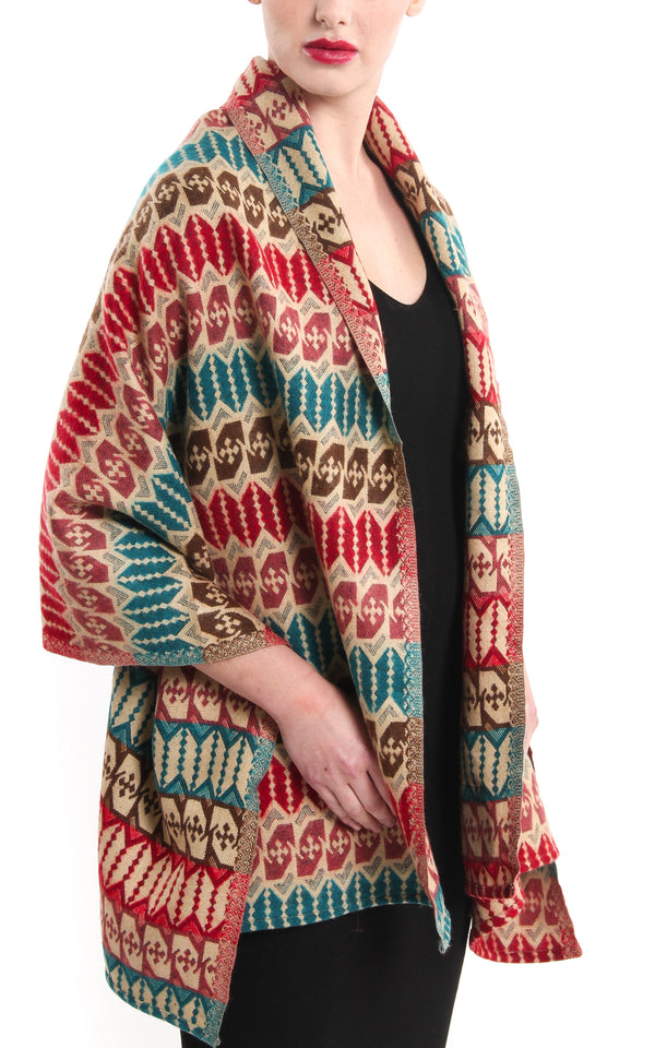 Geometric patterned  Himalayan  Tibet shawl red green blue draped around shoulders